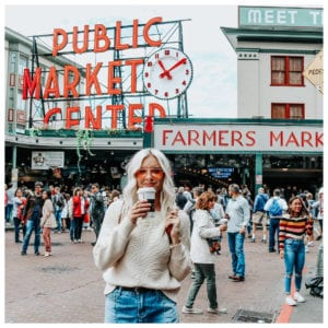 Carly @CarlyMal is a trend setter based in Kelowna, here wearing a sweater and jeans in the market with a coffee
