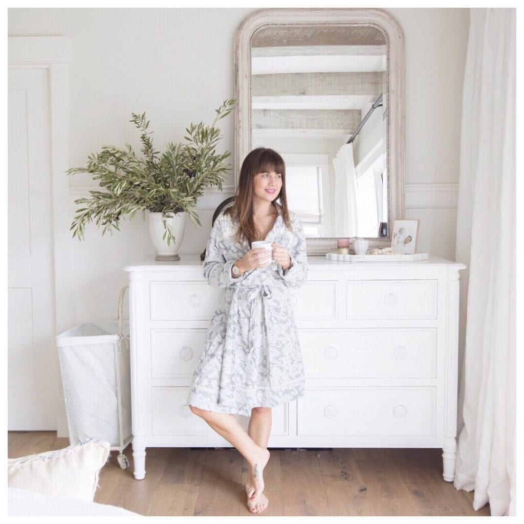 Jillian Harris (@Jillian.Harris) is a fashion influencer and TV star from Vancouver, here she is wearing a pale sundress in a beautiful white bedroom in front of a white dresser
